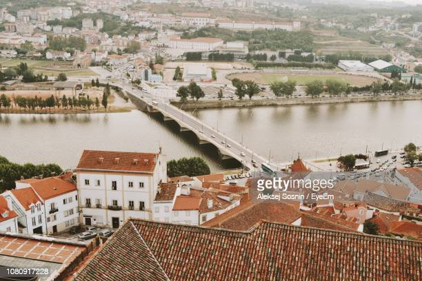 High Angle View Of Townscape By River
