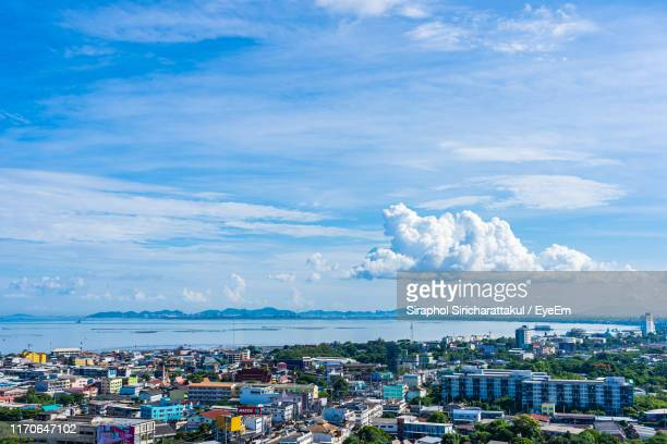high angle view of townscape by sea against blue sky - provinz chonburi stock-fotos und bilder