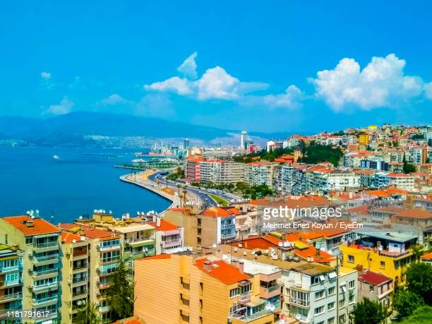 high angle view of townscape by sea against blue sky - izmir stock pictures, royalty-free photos & images