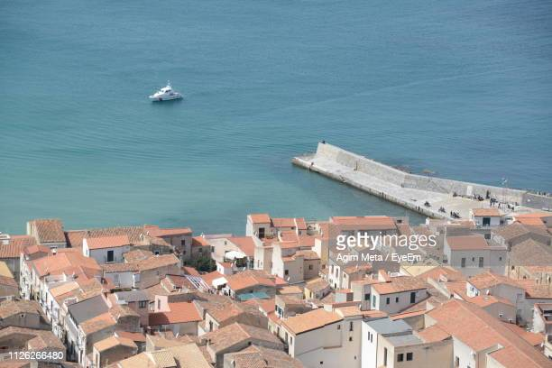 high angle view of townscape by sea against buildings - agim meta stock-fotos und bilder