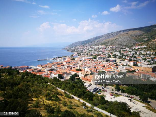 high angle view of townscape by sea against sky - thiem foto e immagini stock