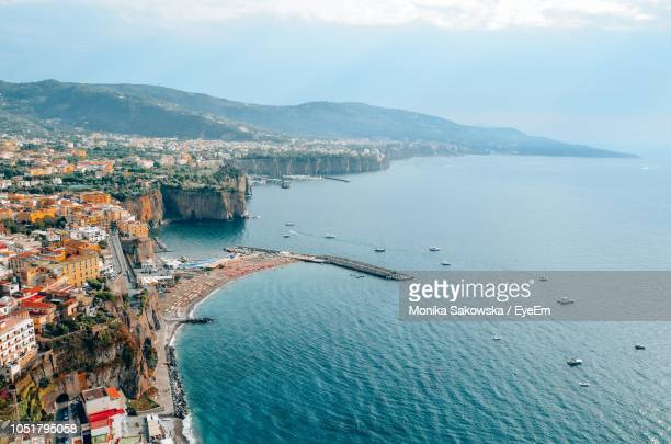high angle view of townscape by sea against sky - sorrento stock pictures, royalty-free photos & images