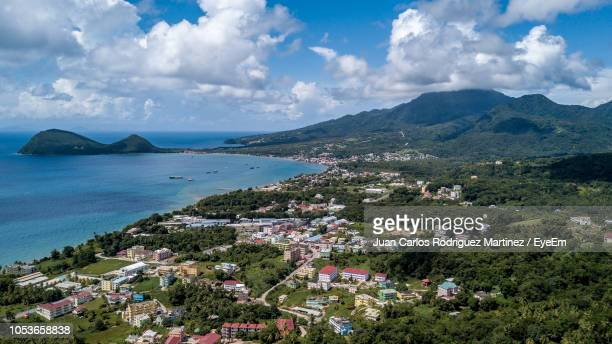 high angle view of townscape by sea against sky - dominica stock pictures, royalty-free photos & images
