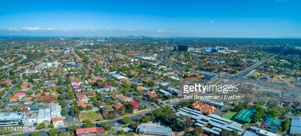 high angle view of townscape by sea against sky - chadstone shopping centre stock pictures, royalty-free photos & images