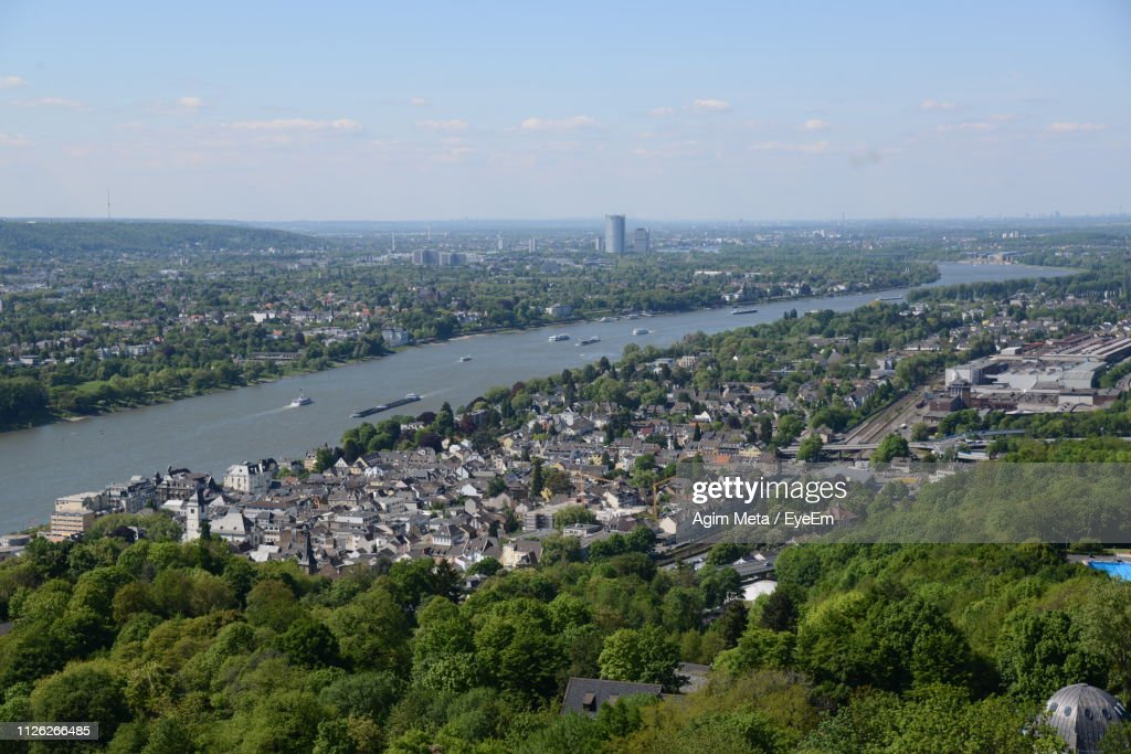 High Angle View Of Townscape By Sea Against Sky : Stock Photo