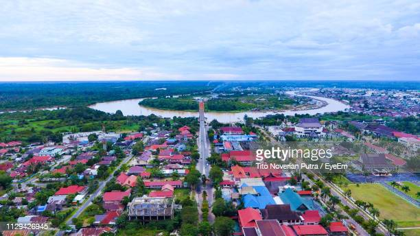 high angle view of townscape by sea against sky - central kalimantan stock pictures, royalty-free photos & images