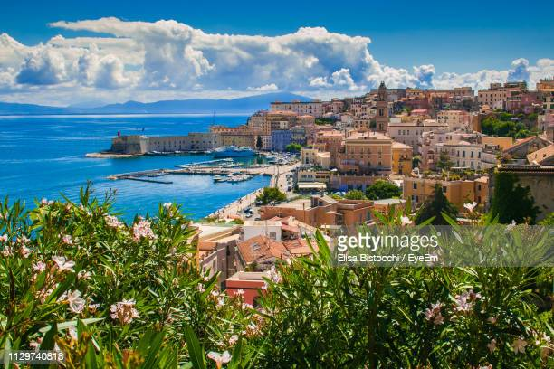 high angle view of townscape by sea against sky - latium stock pictures, royalty-free photos & images