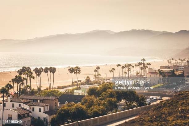 high angle view of townscape by sea against sky - santa monica stock-fotos und bilder