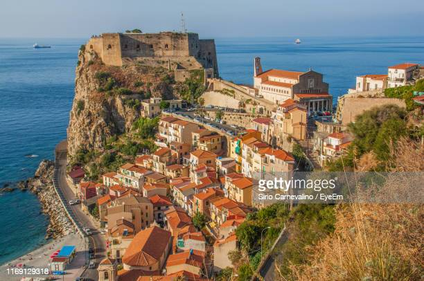 high angle view of townscape by sea against sky - calabria stock pictures, royalty-free photos & images