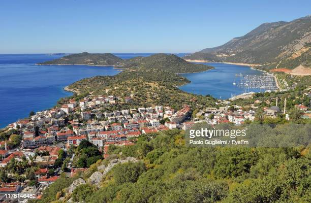 high angle view of townscape by sea against sky - kas stock pictures, royalty-free photos & images