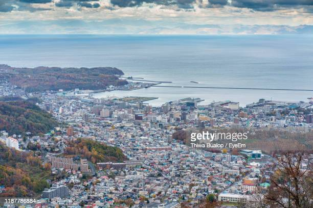 high angle view of townscape by sea against sky - 小樽市 ストックフォトと画像