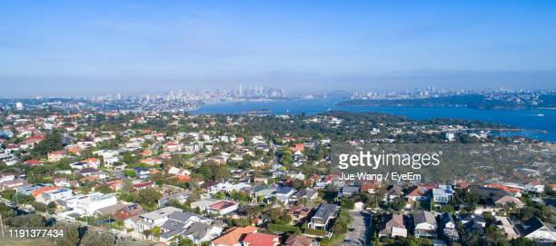 high angle view of townscape by sea against sky - wang he stock pictures, royalty-free photos & images