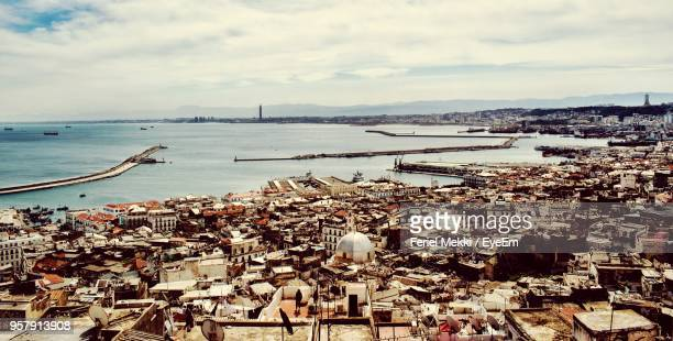 high angle view of townscape by sea against sky - algiers algeria stock pictures, royalty-free photos & images
