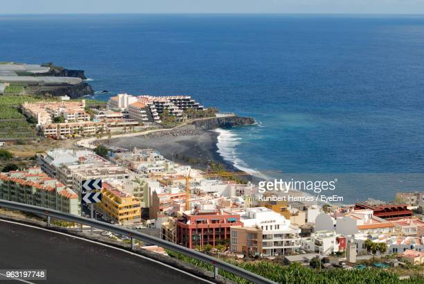 high angle view of townscape by sea against sky - arrecife stock photos and pictures
