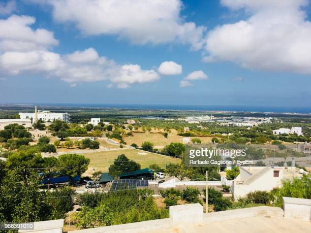 high angle view of townscape by sea against sky - ostuni stock photos and pictures