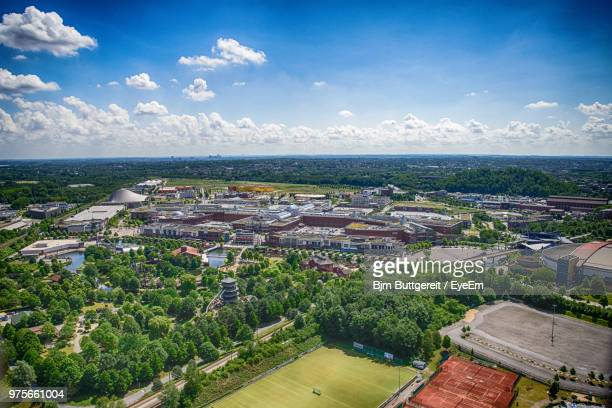 high angle view of townscape by sea against sky - oberhausen stock-fotos und bilder