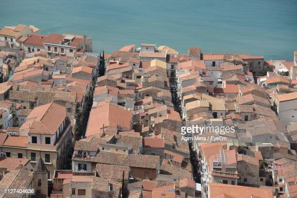 high angle view of townscape by sea - agim meta stock-fotos und bilder