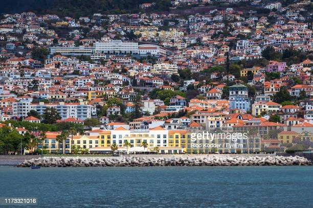 high angle view of townscape by sea - funchal stock pictures, royalty-free photos & images