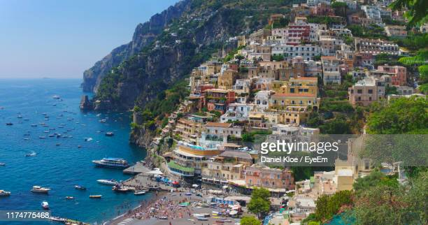 high angle view of townscape by sea - capri stock pictures, royalty-free photos & images