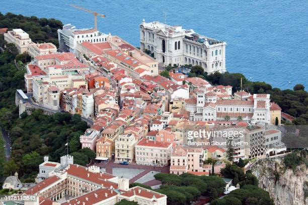 high angle view of townscape by sea - monaco stock pictures, royalty-free photos & images