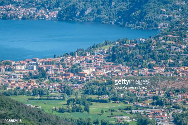 high angle view of townscape by sea - varese stock pictures, royalty-free photos & images