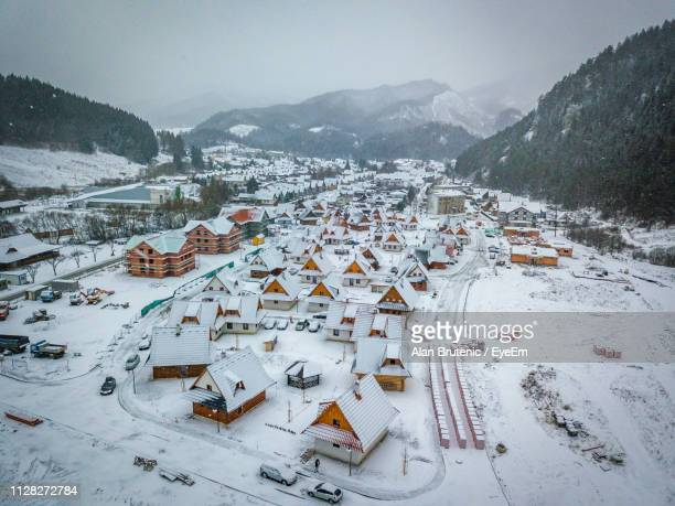 high angle view of townscape by snow covered mountain - slovakia stock pictures, royalty-free photos & images