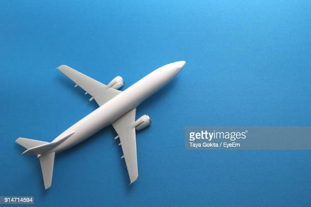 High Angle View Of Toy Airplane On Blue Background