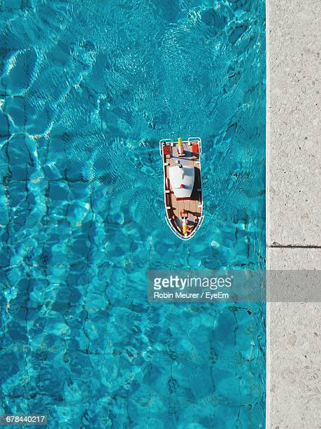 High Angle View Of Toy Boat In Swimming Pool