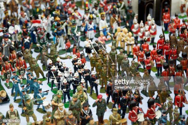 high angle view of toy soldiers on table for sale - army soldier toy stock pictures, royalty-free photos & images