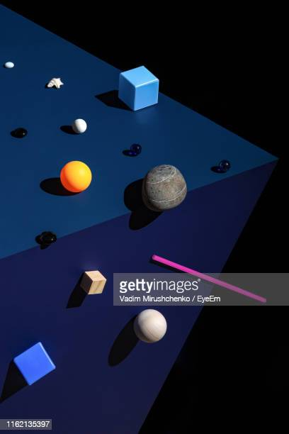 high angle view of toys against blue background - nature morte photos et images de collection