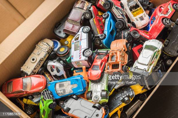 high angle view of toys in box - arrangement stock pictures, royalty-free photos & images