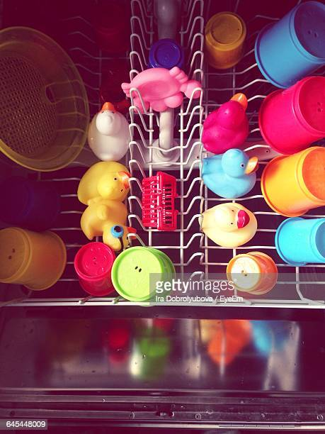 High Angle View Of Toys In Dishwasher