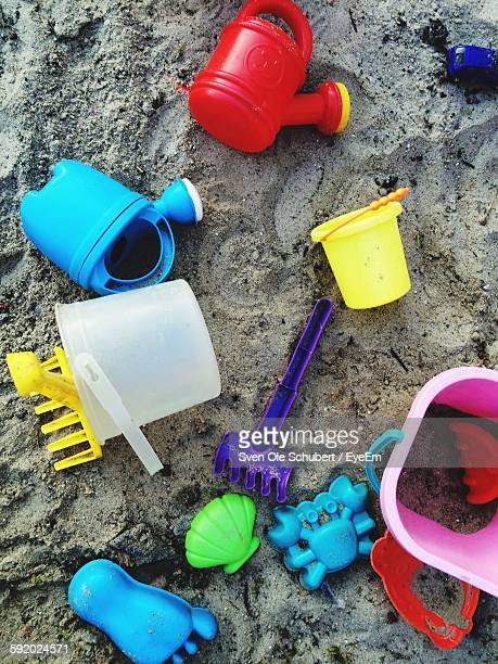 High Angle View Of Toys On Beach