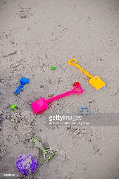 High Angle View Of Toys On Sand At Beach