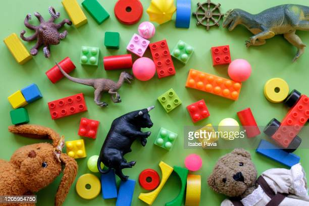high angle view of toys over green background - leisure games stock pictures, royalty-free photos & images