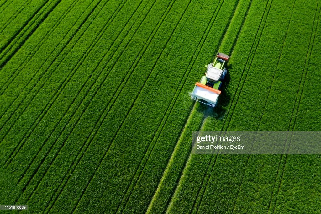 High Angle View Of Tractor On Agricultural Field : Stock Photo