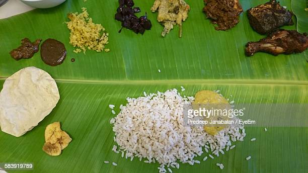 High Angle View Of Traditional Indian Meal Served On Banana Leaf