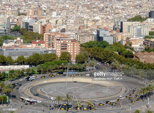 high angle view of traffic circle amidst buildings in city - alexandra krull stock-fotos und bilder