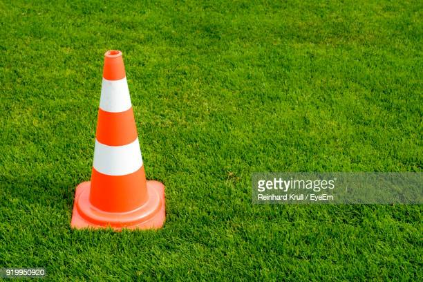 High Angle View Of Traffic Cone On Field