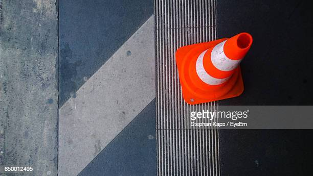 high angle view of traffic cone on railroad station platform - traffic cone stock pictures, royalty-free photos & images