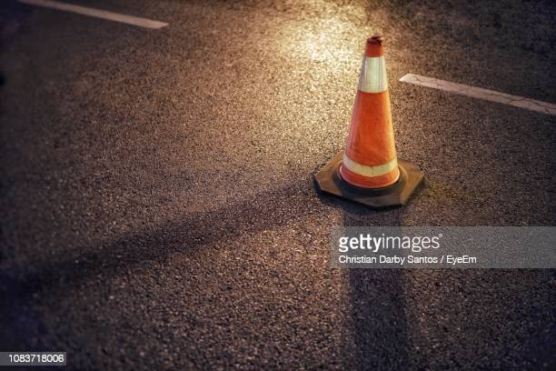 high angle view of traffic cone on road at night - traffic cone stock pictures, royalty-free photos & images