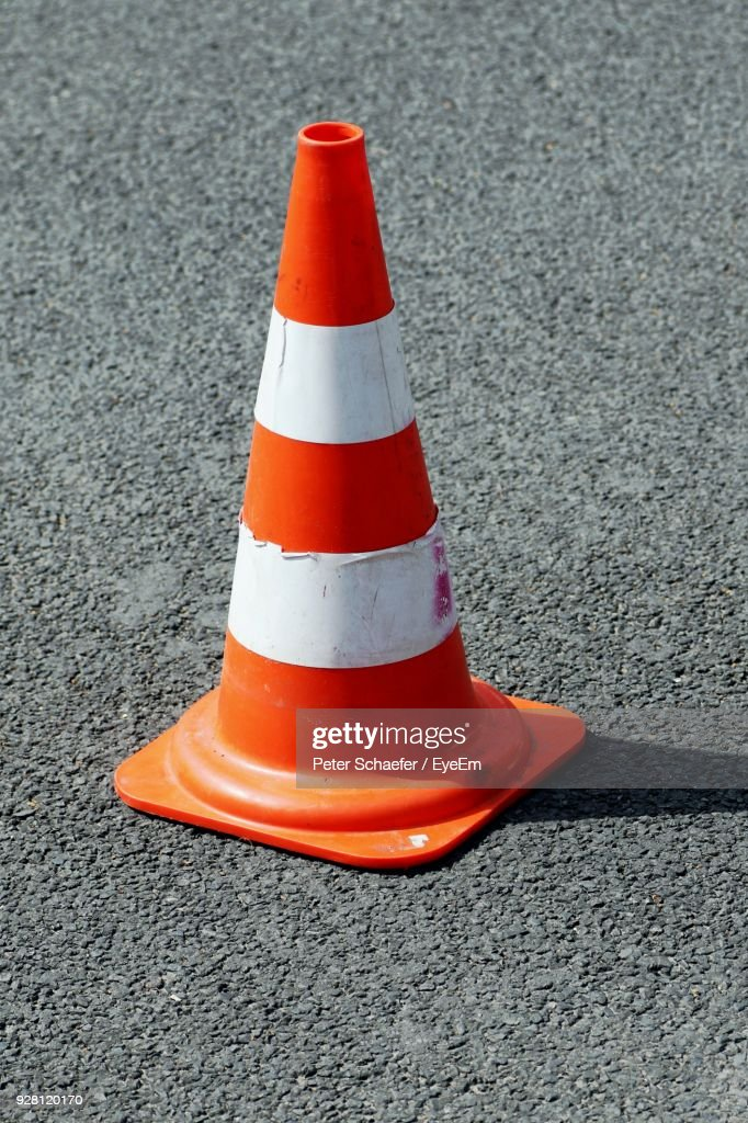 High Angle View Of Traffic Cone On Street During Sunny Day : Stock-Foto