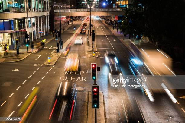 high angle view of traffic on a busy city street at night, london. - london stock pictures, royalty-free photos & images