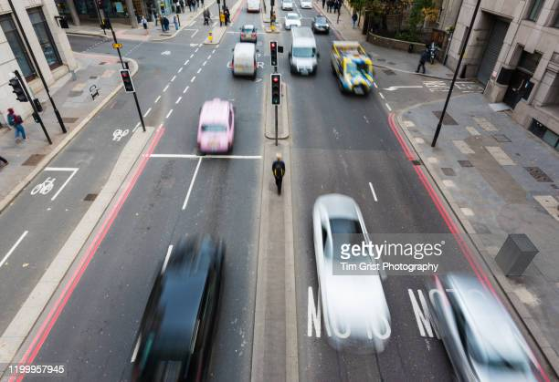 high angle view of traffic on a busy city street - pollution stock pictures, royalty-free photos & images