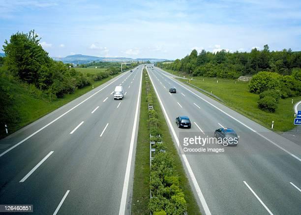 high angle view of traffic on highway - fernverkehr stock-fotos und bilder