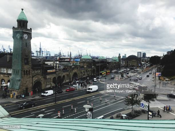 high angle view of traffic on road against buildings in city - hamburg germany stock pictures, royalty-free photos & images