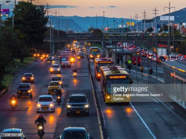 high angle view of traffic on road at dusk - ボゴタ ストックフォトと画像