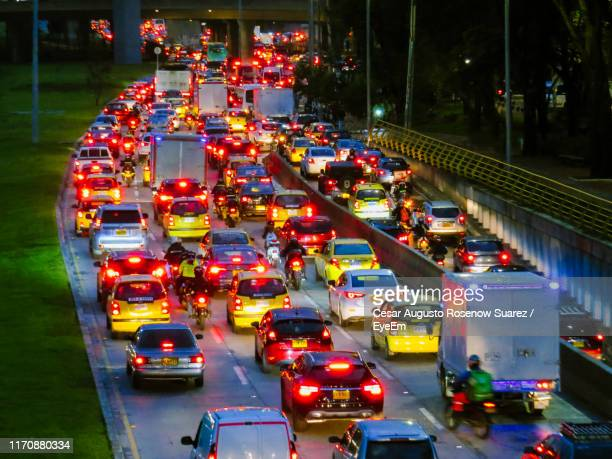 high angle view of traffic on road at night - ボゴタ ストックフォトと画像