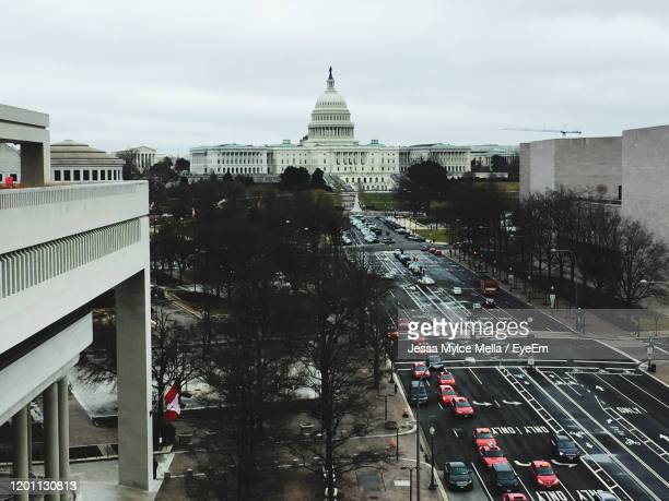 high angle view of traffic on road in city - jessa stock pictures, royalty-free photos & images