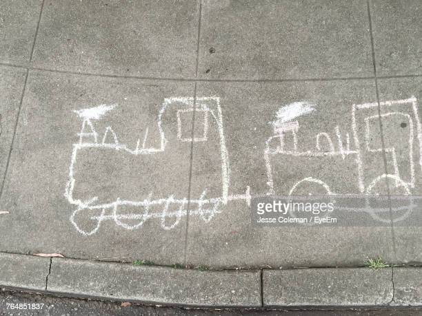 high angle view of train drawing on sidewalk - jesse coleman stock photos and pictures